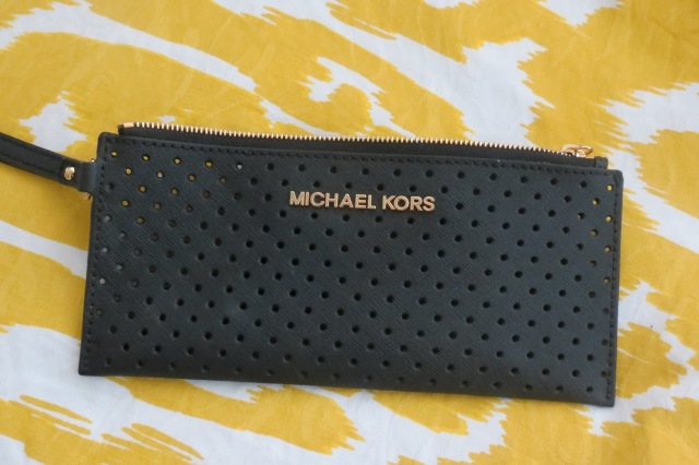 MICHAEL Michael Kors Small Jet Set Perforated Saffiano Clutch in Black